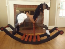 brown and white spotted appaloosa rocking horse