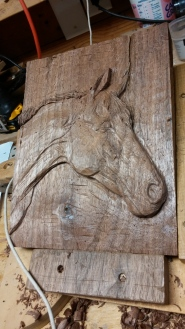 relief carving of horse portrait in reclaimed walnut hand carved horse head