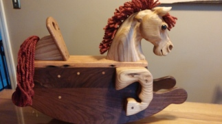 hand carved oak rocking horse with reclaimed lumber