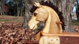 hand carved toddler rocking horse natural wood close up of head