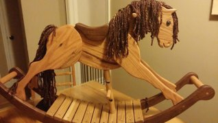 reclaimed oak rocking horse with walnut rockers and yarn mane and tail