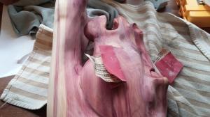 sanding cedar horse head carving after shellac coat