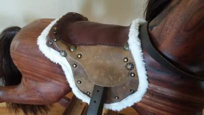 saddle on walnut rocking horse