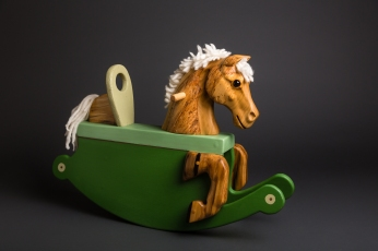 carved reclaimed poplar toddler rocking horse painted green rockers wool mane and tail glass eye
