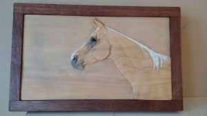 relief carving of palomino quarter horse in poplar with milk paint and oil finish