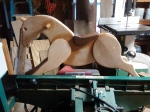 rocking horse made from reclaimed oak standing on grizzly jointer while I work on the rockers