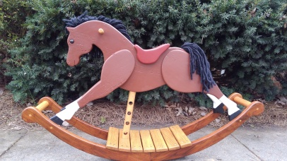 wooden rocking horse made from reclaimed lumber and hand painted with milk paint