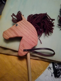 oak stick horse with brown yarn mane