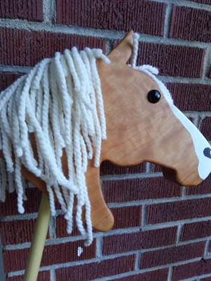 wooden stick horse painted white blaze cherry wood white yarn mane