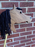 walnut wood stick horse Arabian shape, black mane