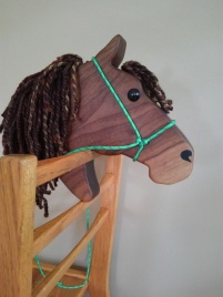walnut hobby horse quarter horse with brown mane, with hand made rope halter adjustable bridle