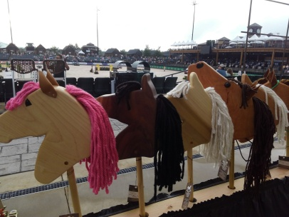 hand made hobby horses set up in front of the arena at Saturday Night Lights Tryon International Equestrian Center Gran Prix