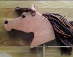 hand made cherry wood hobby horse with brown mane and leather ears