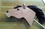 large cherry hand made wood hobby horse with leather ears and brown mane