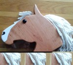 large hand made cherry wood hobby horse with white mane and large white blaze on front and side of face