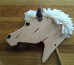 hand made maple wood hobby horse with leather ears and short white mane