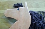 hand made cherry wood hobby horse with brown mane and hand painted eye