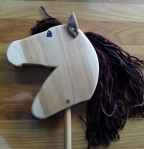 hand made hobby horse with leather ears, hand painted eye and brown mane