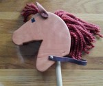 small hobby horse with painted eye and leather ears