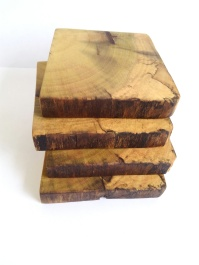 Four wood coasters stacked on top of each other. Wood is spalted poplar