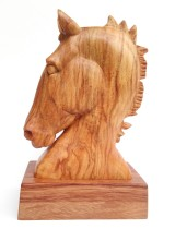 carved horse head in spalted beech wood on bubinga stand