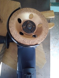 wood grinder attachment shown on blue angle grinder