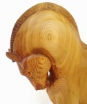 hand carved stylized wood carving of horse on circular walnut stand, close up of horse's neck and head