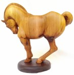 hand carved stylized wood carving of horse on circular walnut stand